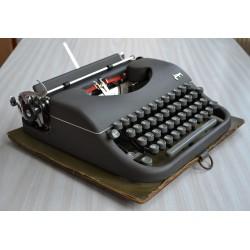 Machine a écrire portative...